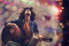 Young man playing guitar. Young man playing the guitar Stock Photos