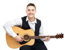 Young man playing on guitar Royalty Free Stock Image
