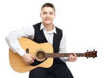 Young man playing on guitar Royalty Free Stock Photos