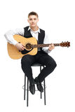 Young man playing on guitar Stock Image