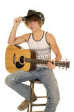 Young man playing a guitar with cowboy hat looking Royalty Free Stock Photos