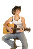 Young man playing a guitar with cowboy hat smile Royalty Free Stock Images