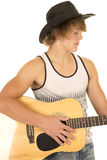 Young man playing a guitar with cowboy hat tank top Stock Photo