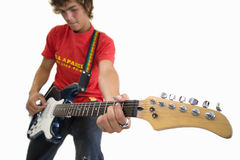 Young man playing on guitar, cut out Royalty Free Stock Photo