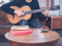 Young man playing guitar at home Royalty Free Stock Images