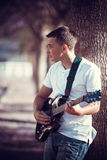 Young man playing a guitar Stock Photography
