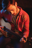 Young man playing guitar. In pub Stock Image