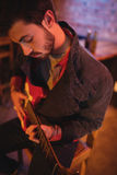 Young man playing guitar. In pub Stock Images