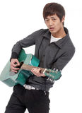 Young man playing guitar Royalty Free Stock Photography
