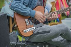Young Man Playing The Guitar At The Vondelpark On Kingsday Amsterdam The Netherlands 2018.  Royalty Free Stock Image