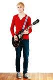 Young man playing guitar Stock Photos