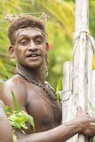 Pan flute musician Solomon Island, South Pacific Ocean. Young man playing handmade panpipe called the `South sea flute` for ceremony on Solomon Islands Stock Image
