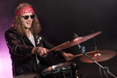Young man playing hard rock music with drums set Royalty Free Stock Images