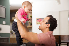 Young man playing with his daughter Royalty Free Stock Image