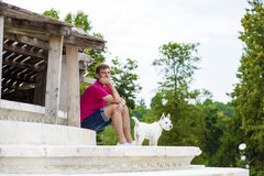 Young man playing with his dog in the park Royalty Free Stock Photos