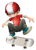 A young man playing with his skateboard Royalty Free Stock Photography