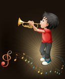A young man playing with his trombone Royalty Free Stock Photo