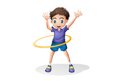 A young man playing with the hulahoop Stock Photos