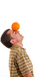 Young man playing with orange Stock Photography