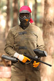 Young man playing paintball Stock Photo