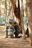 Young man playing paintball Royalty Free Stock Photos