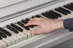 A young man playing piano closeup. Royalty Free Stock Photo