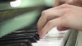 Young man playing the piano. hands close up. exercises on the musical instrument. keyboard musical instrument. salfegio. long fing. Ers of a musician. musical stock video footage
