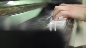 Young man playing the piano. hands close up. exercises on the musical instrument. keyboard musical instrument. salfegio. long fing. Ers of a musician. musical stock video