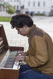 Young man playing the piano in the street,kazan,russian federation Stock Image