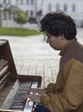 Young man playing the piano in the street,kazan,russian federation Stock Photos