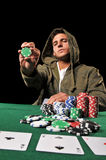 Young man playing poker Royalty Free Stock Image
