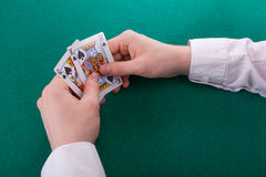 A young man is playing poker Stock Image