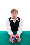 A young man is playing poker Stock Photo