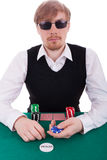 A young man is playing poker Royalty Free Stock Photos