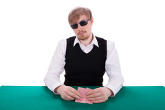 A young man is playing poker Royalty Free Stock Image
