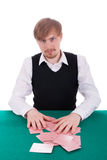 A young man is playing poker Royalty Free Stock Photography