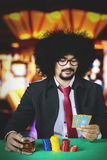 Young man playing poker cards Stock Images