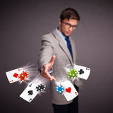 Young man playing with poker cards and chips Royalty Free Stock Photography
