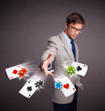 Young man playing with poker cards and chips Stock Image