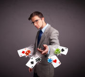 Young man playing with poker cards and chips Royalty Free Stock Image