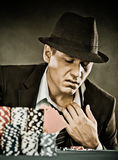 Young man playing poker Stock Photography