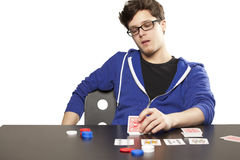Young man playing poker Stock Images