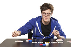 Young man playing poker Royalty Free Stock Photography