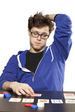 Young man playing poker Royalty Free Stock Photos