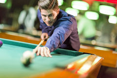 Young man playing pool Royalty Free Stock Image