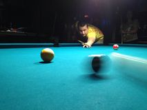 Young man playing pool Stock Image