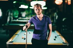 Young man playing pool Stock Photo