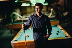Young man playing pool Royalty Free Stock Photo