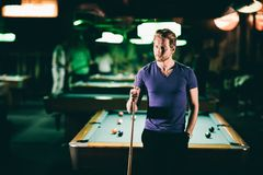Young man playing pool Stock Photos