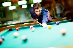 Young man playing pool Stock Photos